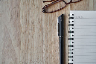 Canva - Notebook, Pen and Reading Glasse