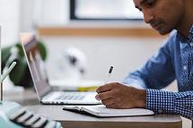 Man writing large