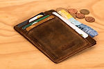 Wallet on wood table condensed