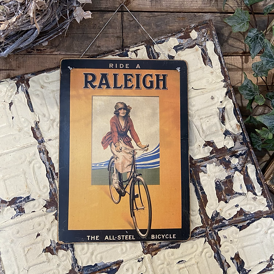 A Vintage Raleigh Cycle Poster Mounted on Board