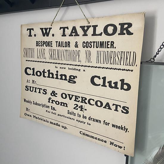 A Vintage Cardboard Shop Advertising Sign