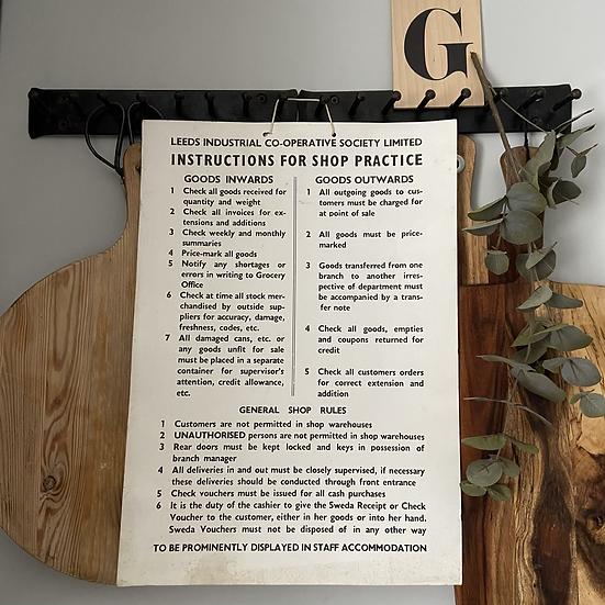 A Vintage Cardboard CO-OP Shop Practice Sign