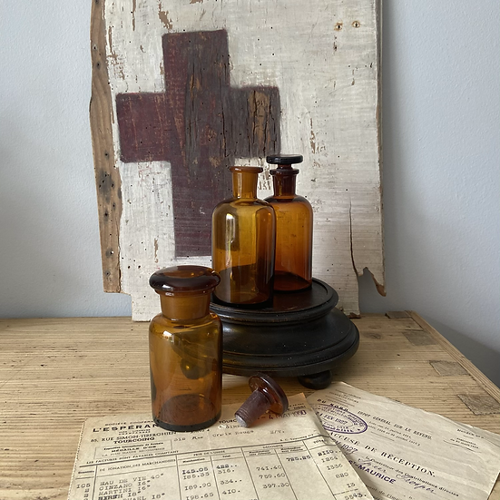 Set of Three Amber Glass Apothecary Bottles with Glass Stoppers.