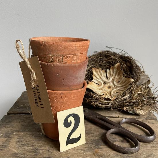 A Set of Three Vintage Terracotta Plant Pots