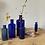 Thumbnail: A Set of 5 Antique Blue Glass Bottles