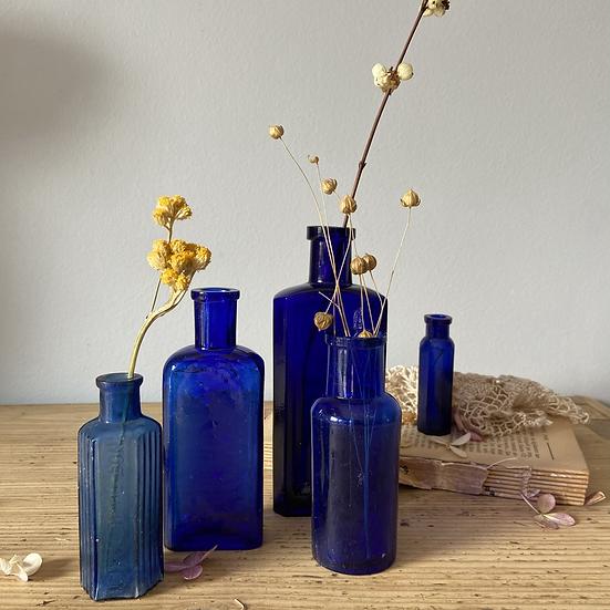 A Set of 5 Antique Blue Glass Bottles