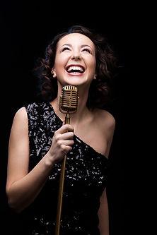happy-beautiful-girl-singer-laughing-hol
