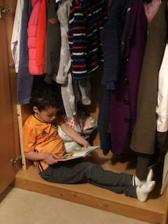 Reading in the wardrobe