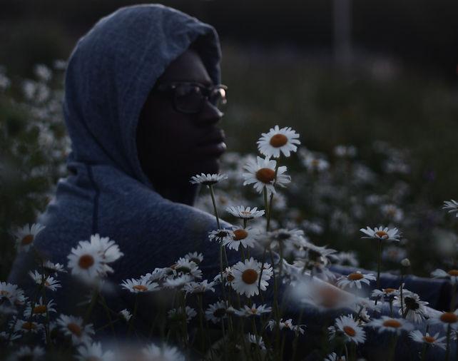 man-flowers-lawn-meadow_edited_edited.jp