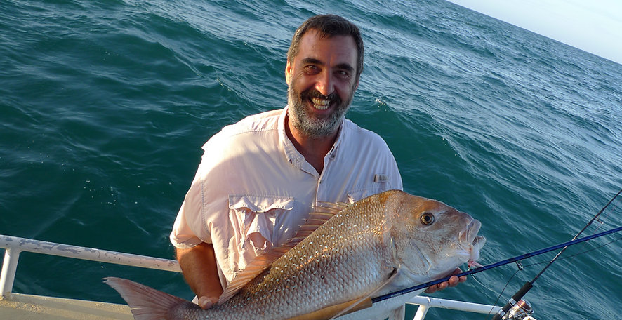 IGFA Capt. Allan Bevan hold a ripper pink snapper caught on fly.