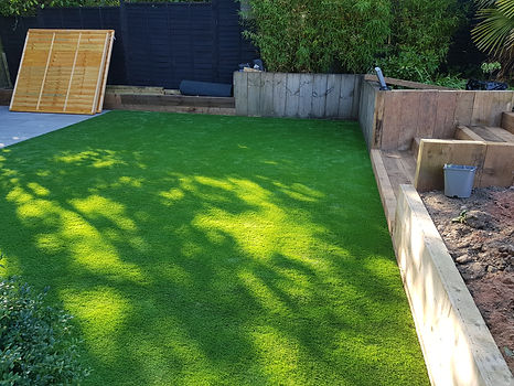 artificial lawn grass installation astro turf sleeper wall sleeper steps