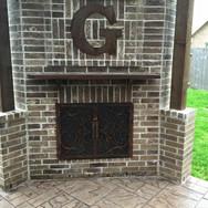 Metal Fireplace Doors and Initial Sign