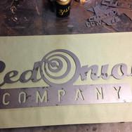 Metal company sign