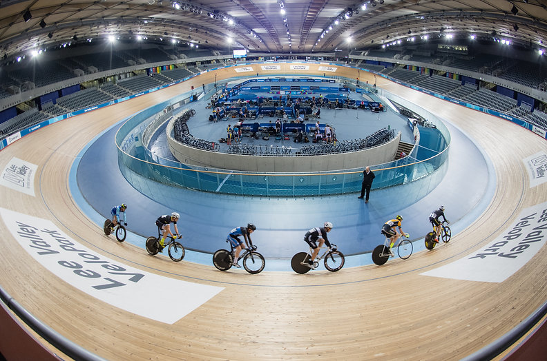 Cyclists on indoor velodrome track