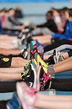 Two rows of kids feet together in trainers