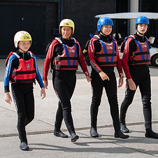 Group of people dressed in wetsuits