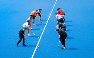Players training on hockey pitch