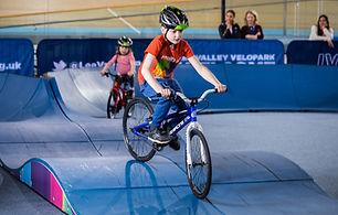 Boy cycling indoor pump track