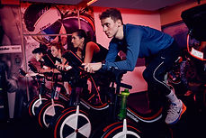 Adults cycling in the VeloStudio