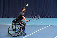 Wheelchair tennis player on indoor courts