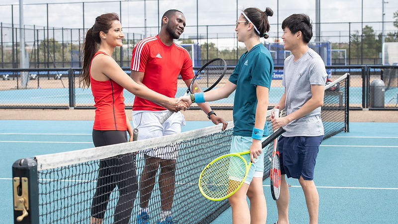 Tennis players on outdoor tennis courts
