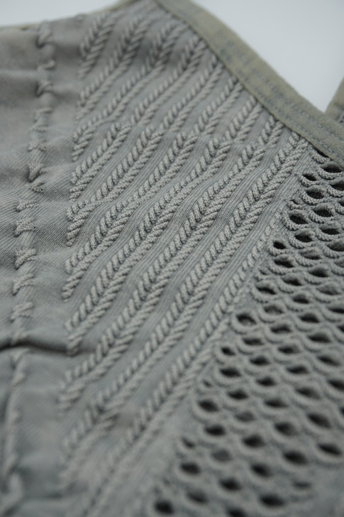 Seamless eyelet and cable knit