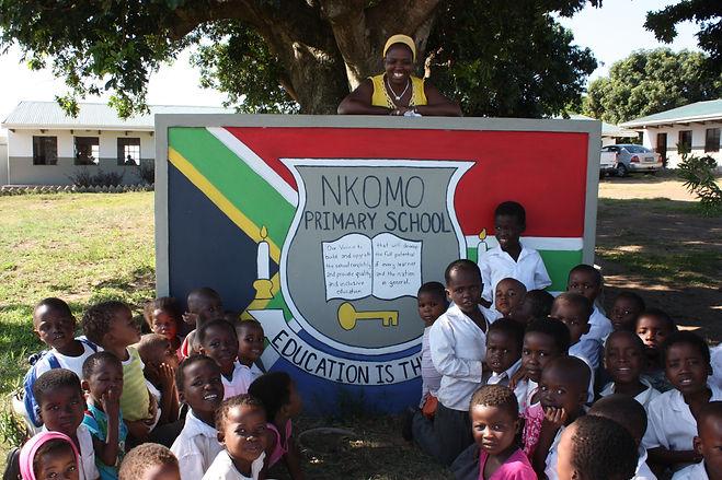 Nkomo Mrs Z w_kids at Sign.JPG