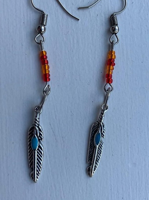 Eagle feather earrings with fire colours