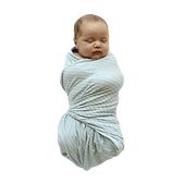 baby beluga at the nest swaddles.png