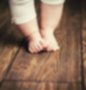 Baby feet doing the first steps. Baby's