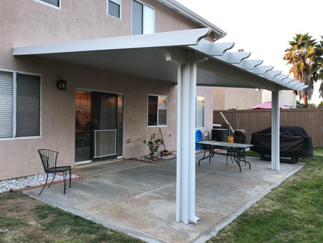 Solid white patio cover installation in Fallbrook