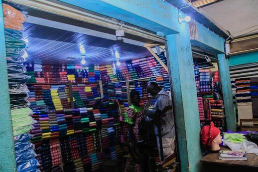 Ita-Osu-Market-Fabric-trader-enjoying-un