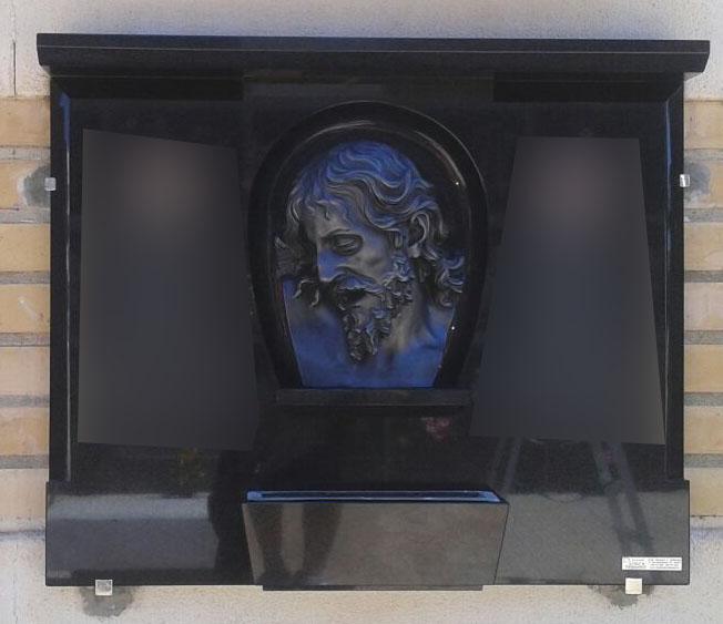 Lapida escultura cabeza de Cristo