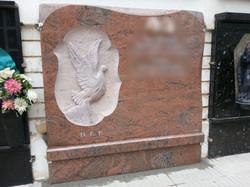Lapida escultura manos paloma
