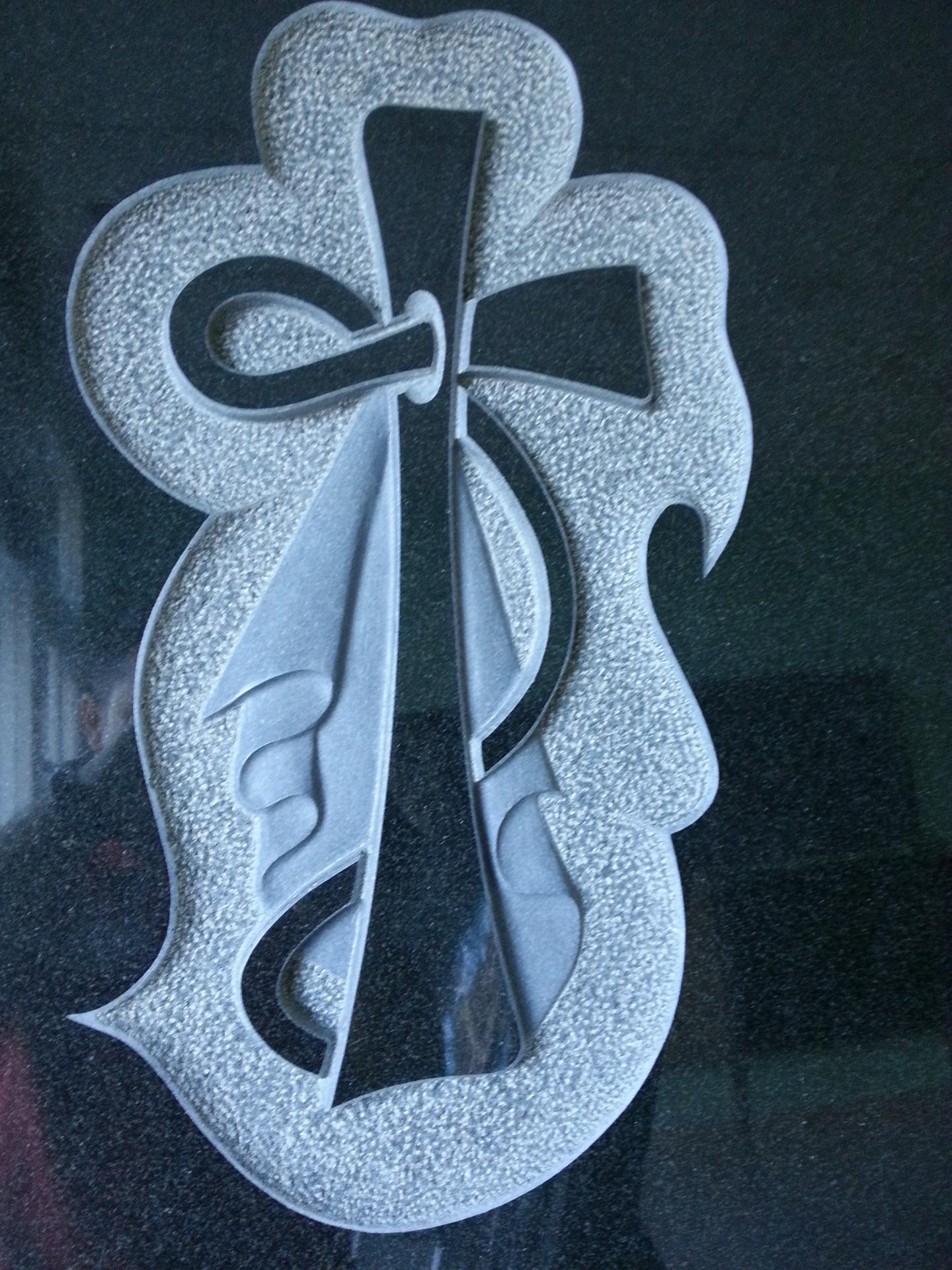 Lapida cruz con manto