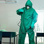 Person in hazmat sanitizing the room by