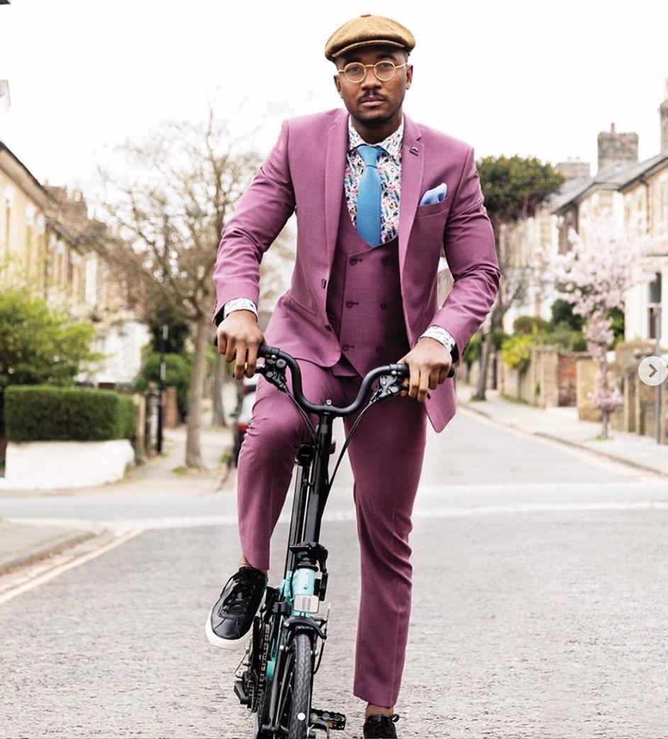 three piece suit, pink suit, floral shirt, blue tie