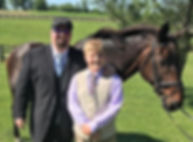 Matt, the owner of RipTide Productions DJ services, is pictured with his son at a Kentucky horse farm.