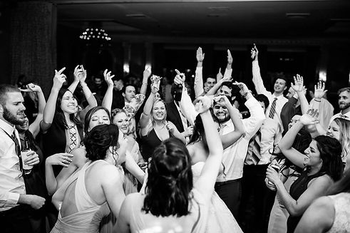 black and white photo of Kentucky wedding crowd on dance floor having fun. RipTide Productions DJ services.