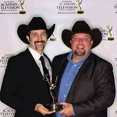 Matt, founder of RipTide Productions DJ services, with Emmy award