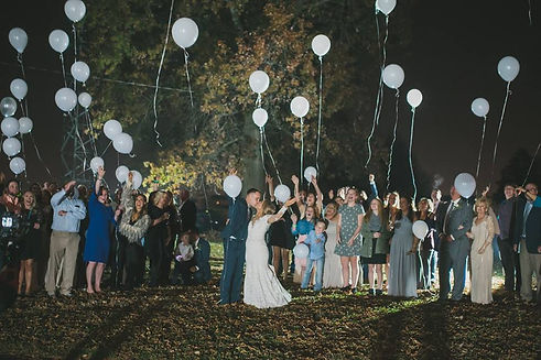 Outside Kentucky wedding celebration with balloon release at RipTide Productions event.