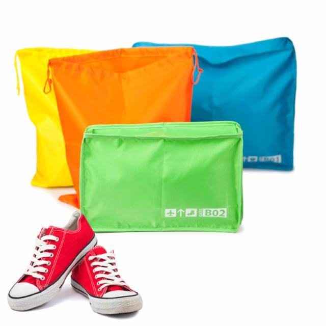 set-de-4-pochettes-colorees-de-voyage-pour-vetements-et-chaussures