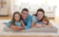 Family-On-Floor-In-Living-room.jpg