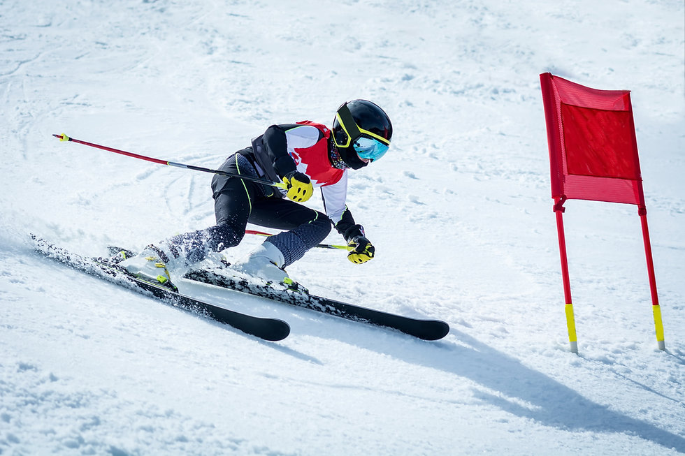 young skier in action in slalom ski comp
