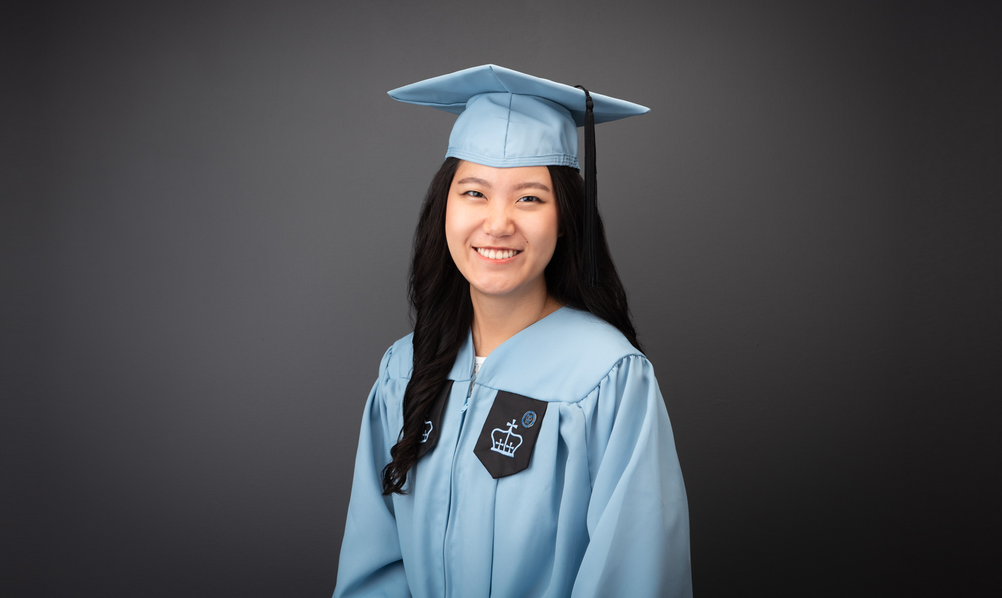 With Graduation Gown