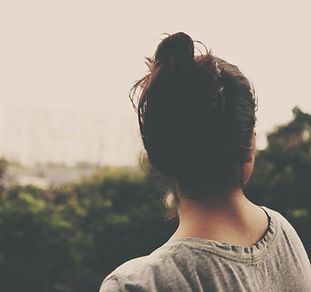 back of woman's head staring into the distance