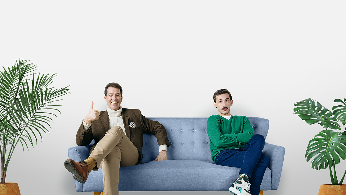 A character representing WordPress and a website designer are sitting on opposite ends of a sofa. WordPress is smiling and giving a thumbs up, the designer looks frustrated.
