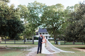 bride and groom in front of house.jpg