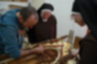 Consultation with Catholic Church customers about wood carved altar