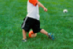 young_orange_kid_kickidaball_soccer_ball